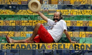 Chilean artist Jorge Selarón on the stairs he spent 20 years decorating. Photograph: Antonio Scorza/AFP